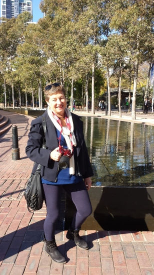 Darling Harbour. Wearing navy jacket over blue wool tunic.