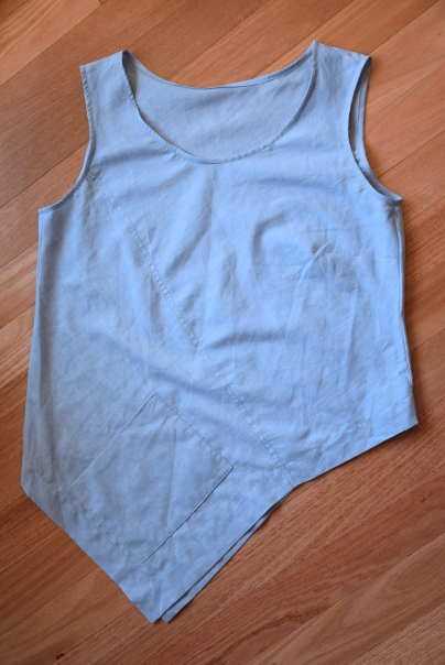 Asymmetrical top,  top stitched.