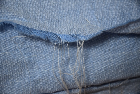 Close up of linen chambray. with a light warp and a white weft.  Love the light blue.