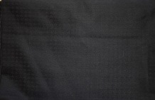 Black wool for a kneed length jacket with leather trim.